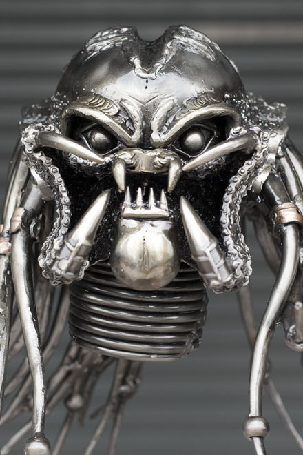 Predator scrap metal sculpture face zoom