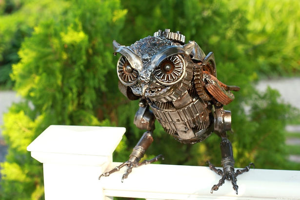 Owl metal sculpture made of recycled scrap metal, left