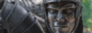roman metal sculpture face