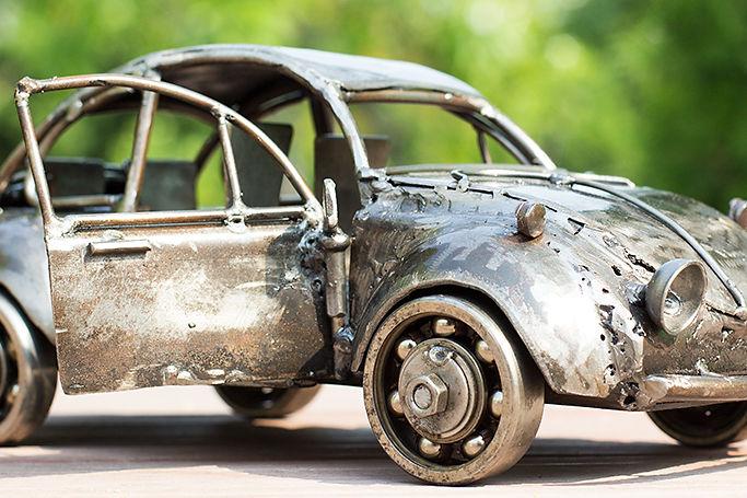 Vintage folk car model sculpture made from scrap steel.