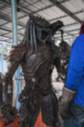 burning process scrap metal artwork predator alien