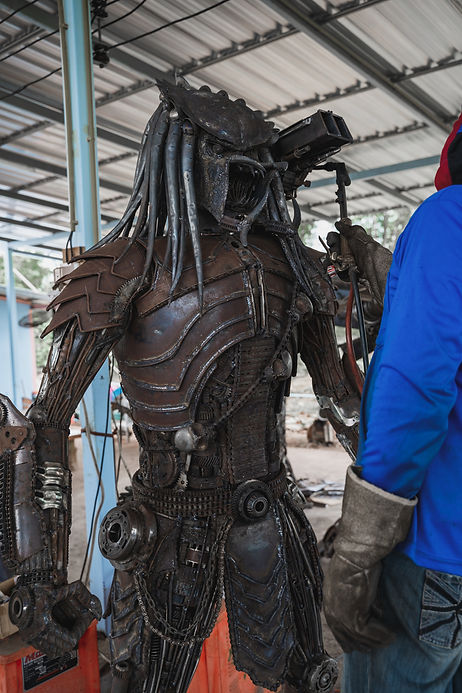 burning process scrap metal artwork predator alien