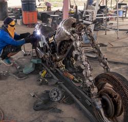 making scrap metal sculpture by mari9art