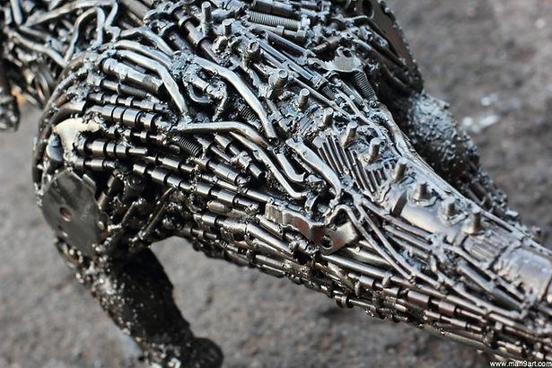 Scrap metal animal art work in dinosaur, back