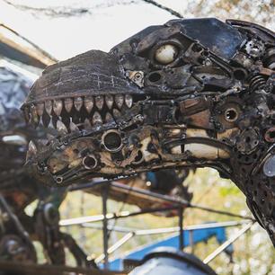 Raptor dinosaur scrap metal art sculpture