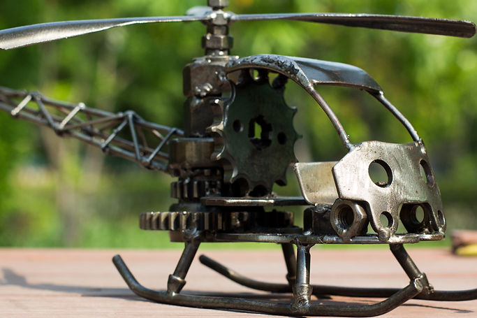 Helicopter bell model scrap sculpture made from scrap steel.