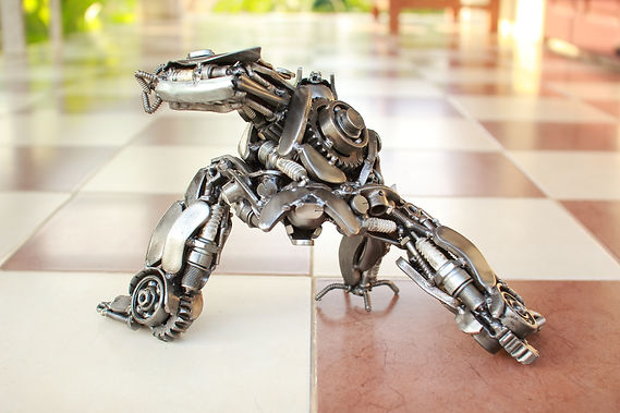 optimus prime scrap metal sculpture behind