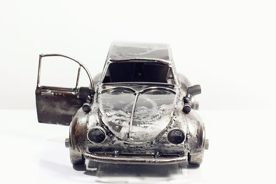 Vintage folk car model sculpture made from scrap iron front.
