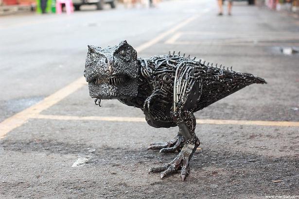 Scrap metal animal art work in dinosaur, front left