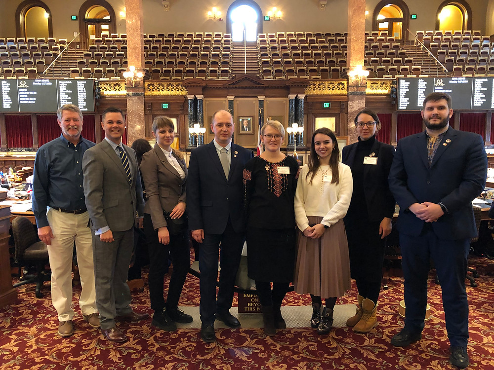 Ukrainian delegates meet Iowa State Senator Zach Nunn on the Senate floor.