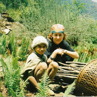 Paula with young boy gathering fire wood