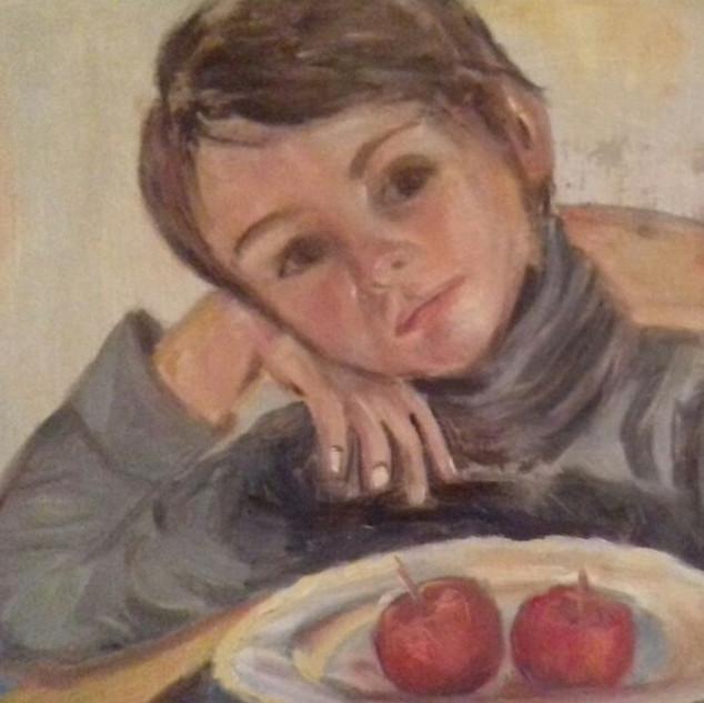 Junge mit Äpfeln