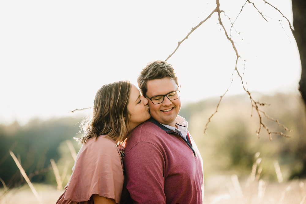 Engagement photography in a field in fall