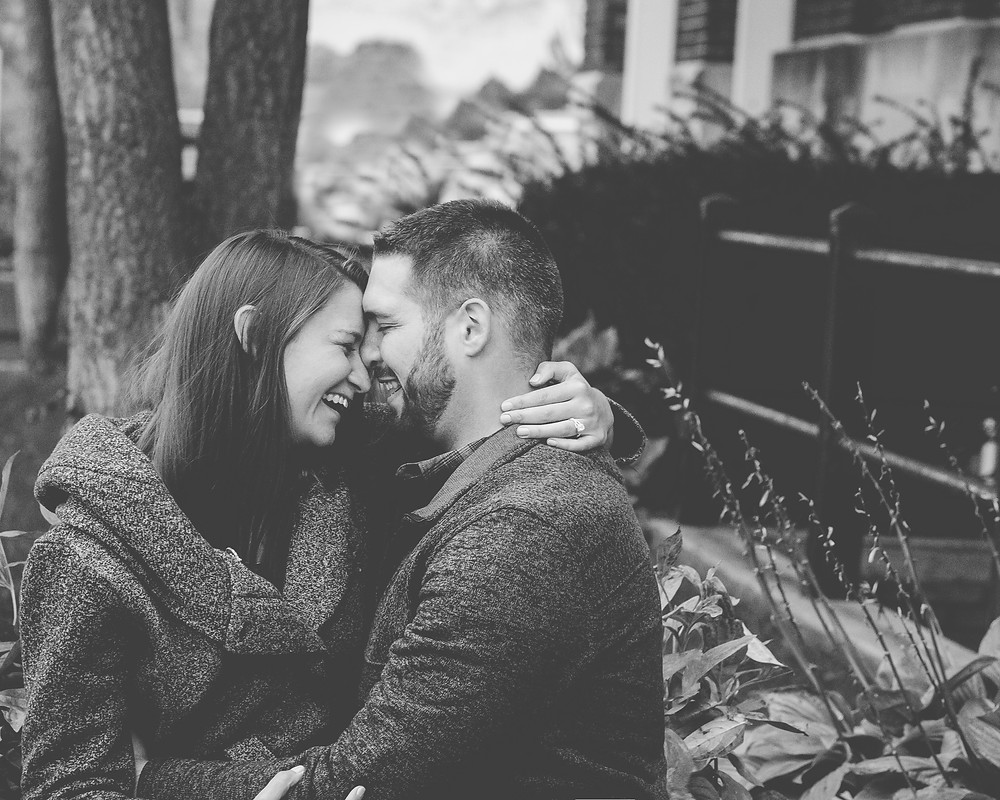 Couple laughing during engagement photography