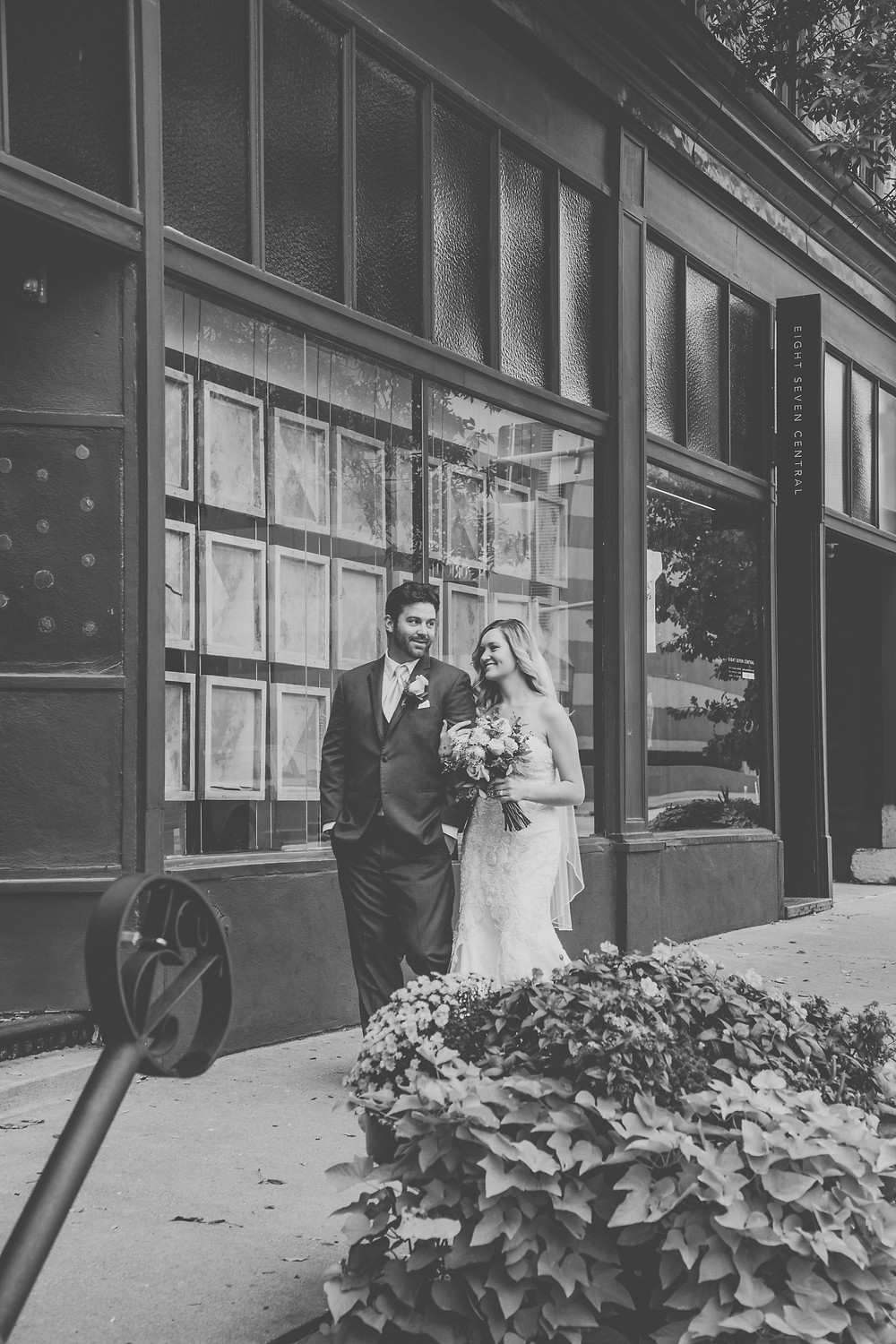 Bride and Groom walk down the street in downtown Des Moines.