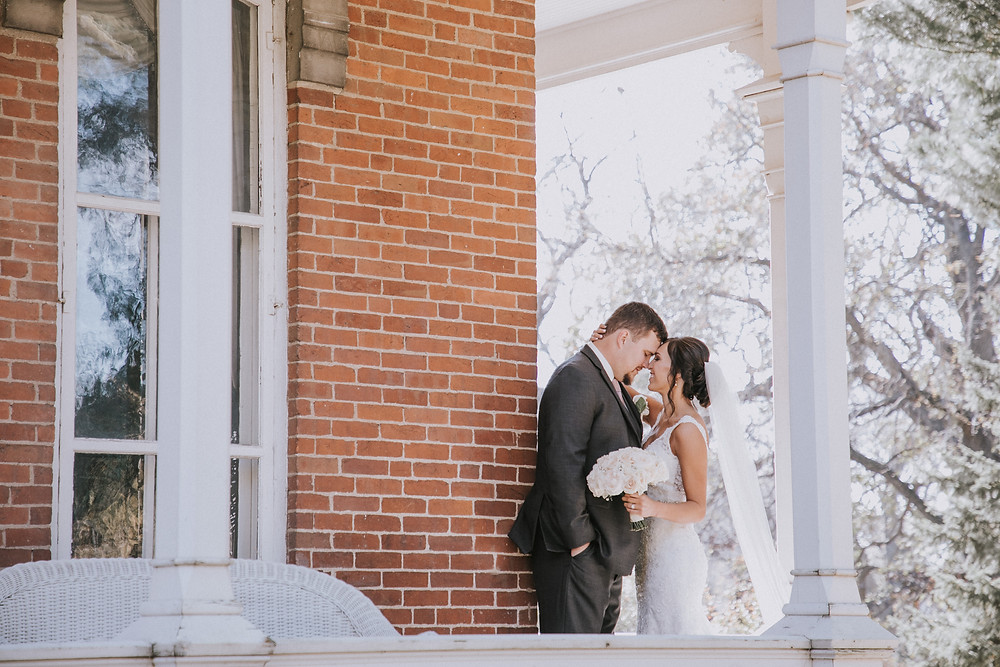 Bride and groom on a porch in Iowa.