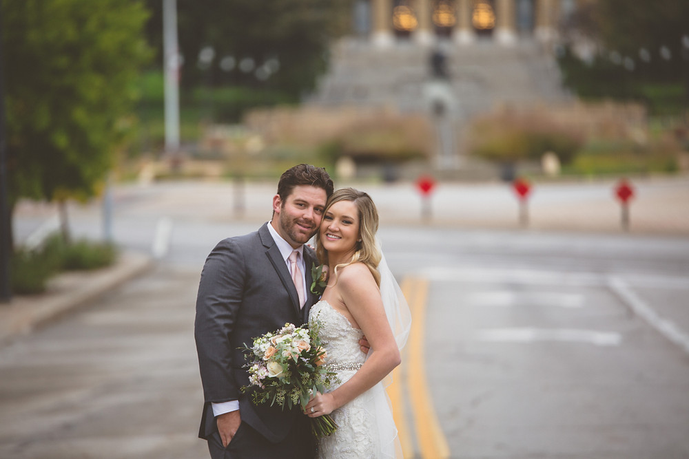 Thisday Photography capturing Bride and Groom in front of the Iowa State Capital Building in Des Moines, Iowa.