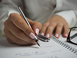 A person writing in a notebook