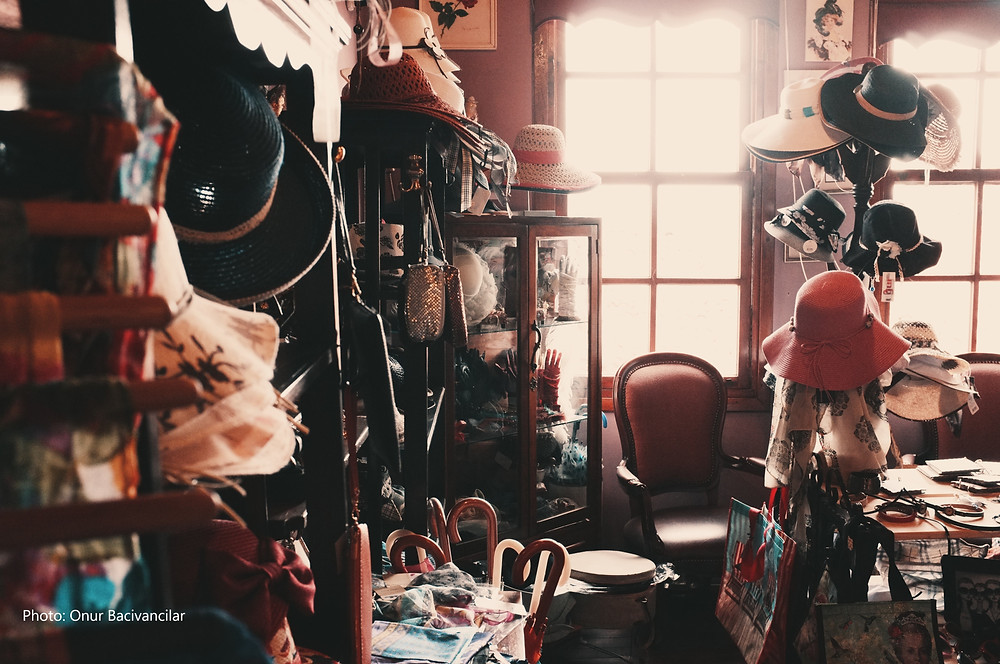 clutter, hats, bags and umbrellas