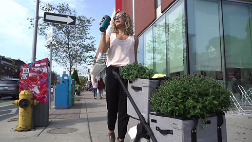 Female shopper with VOOMcart on sidewalk