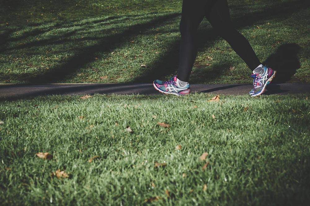 Running feet through a park