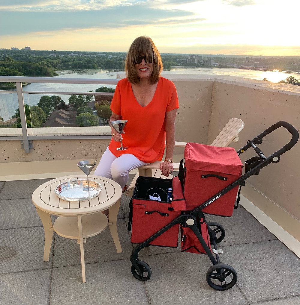 Woman sitting on condo terrace with a red VOOMcart.
