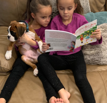 What could be any cuter than five-year-old twin girls holding a puppy?