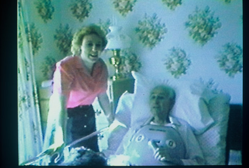 Cazzolli visits patient using a chest shell to support breathing in 1984