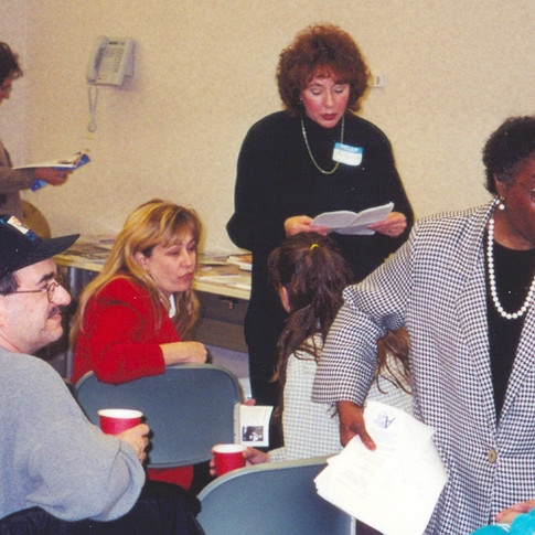 15.  Joan Warren MSW counsels patient families at support meeting.jpg