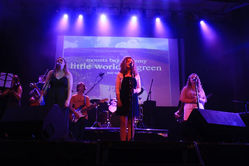 Daisy and band on stage copy.JPG
