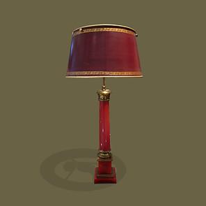 Lámpara de mesa en baquelita roja y pantalla en tole y cuero rojo. Pierre Lotier.