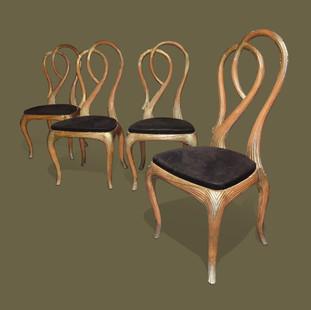 Juego de cuatro sillas en madera tallada, escayolada y dorada imitando gavillas de paja.