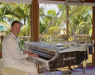 Photo of Ken Davis on his crystal piano