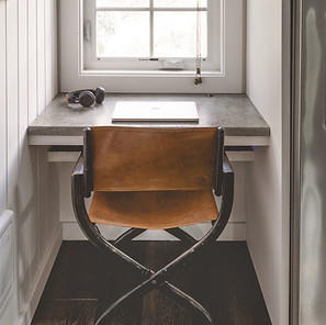 Concrete desk and leather chair