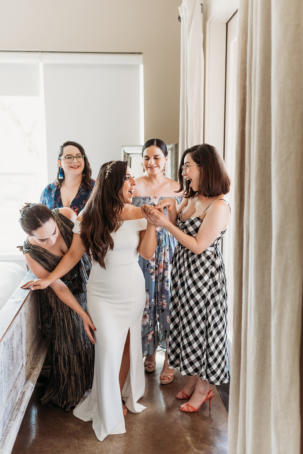 bride surrounded by her sisters while getting ready for her elopement
