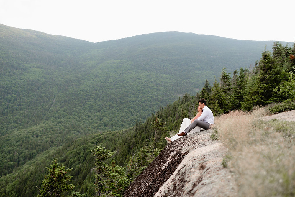 bride and groom sitting down enjoying the view of mount willard during their elopement