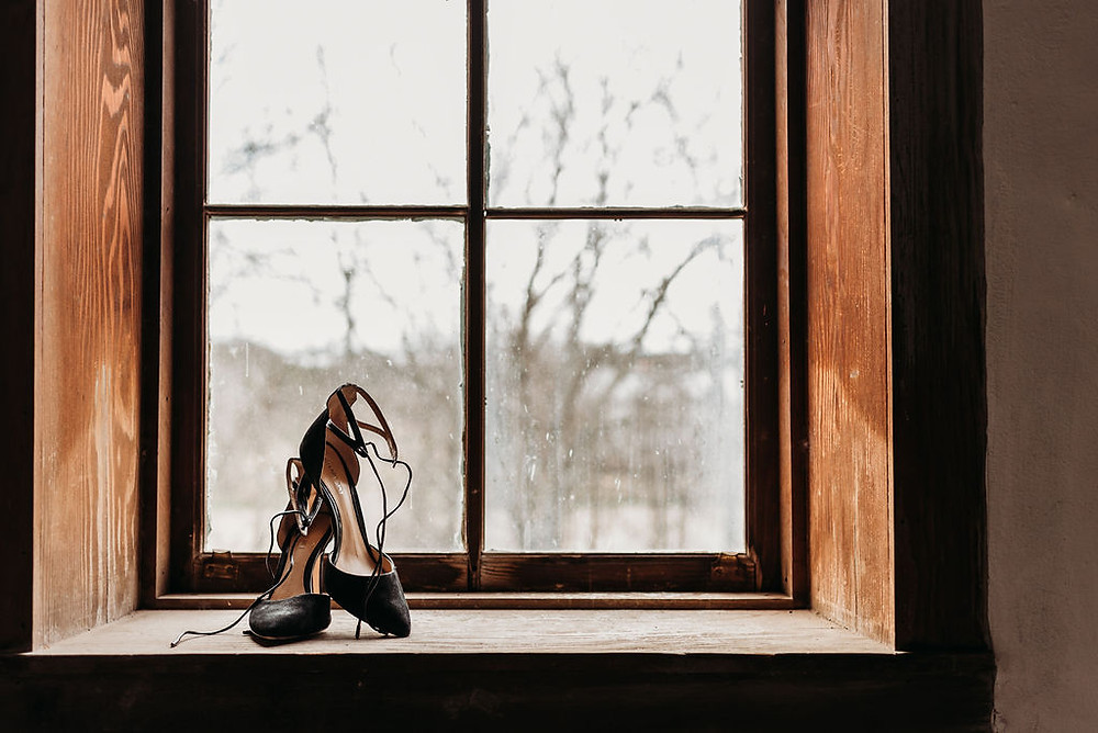 wedding shoes in a window frame