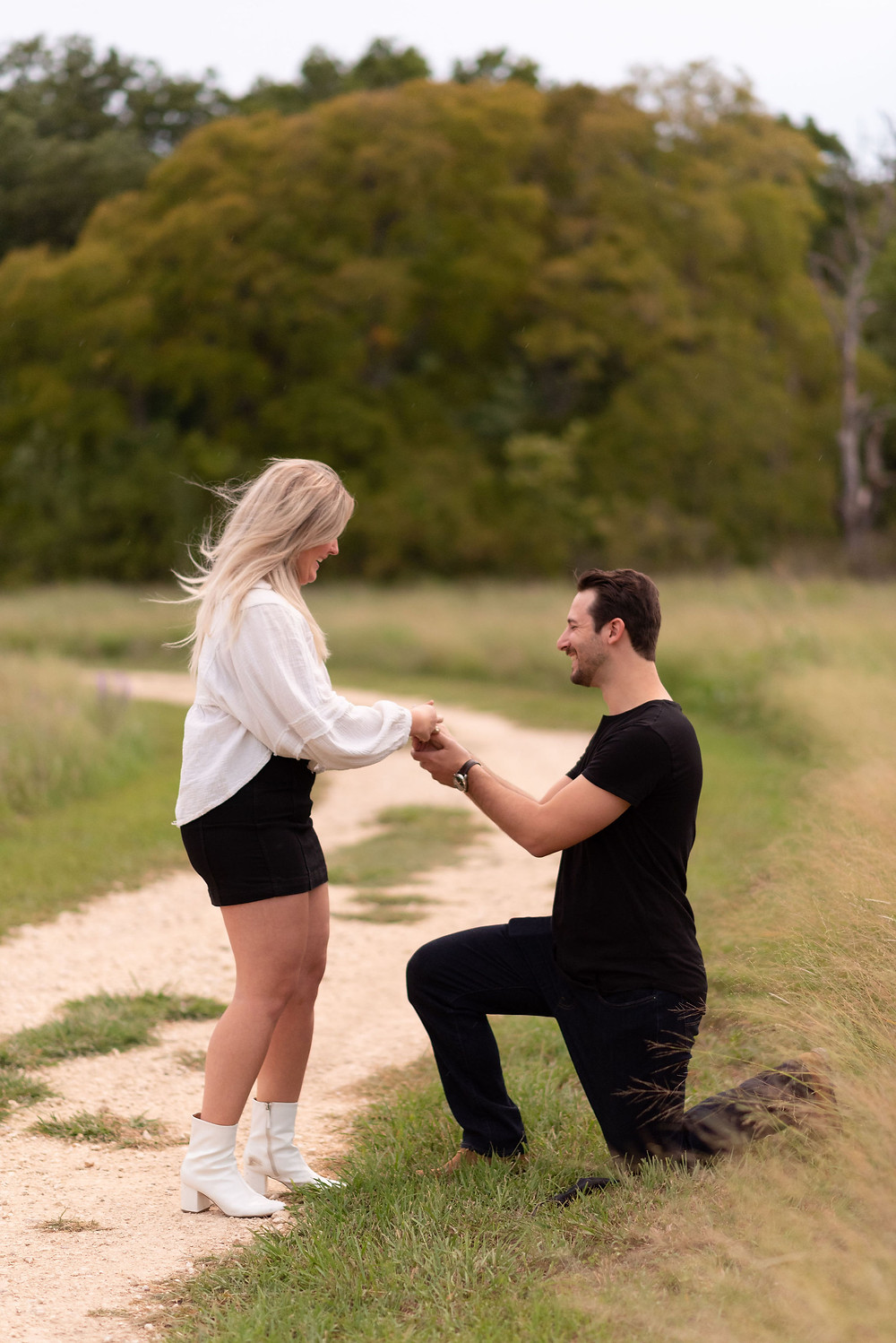 guy down on one knee during proposal