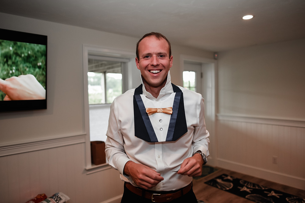 groom wearing dog's collar for wedding