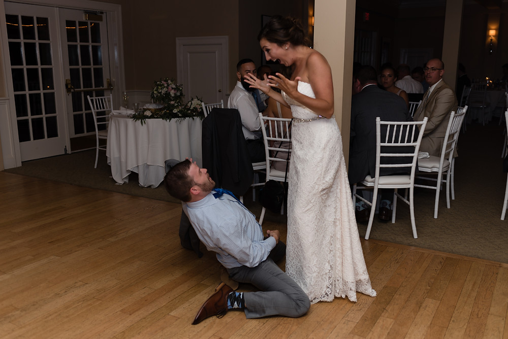 candid photo of guests during wedding at brookside country club