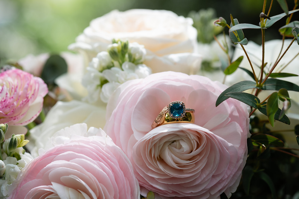 wedding rings in bridal bouquet's flowers