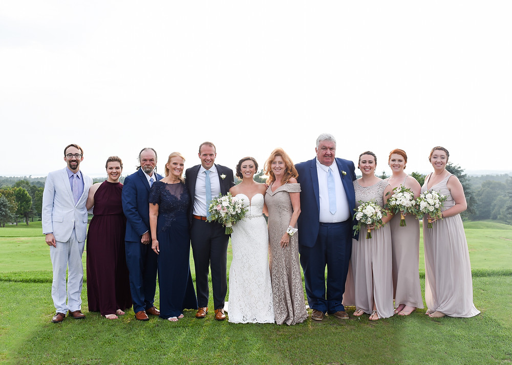 big group photo of bride and groom's families together