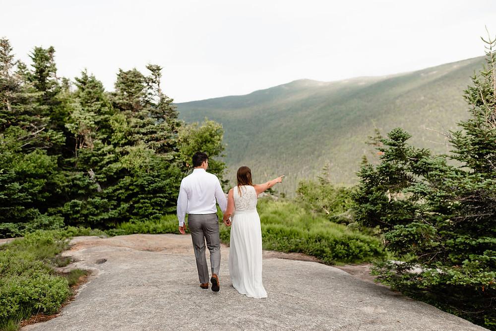 couple exploring summit of mount willard