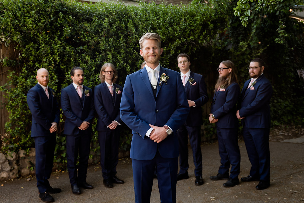 groom standing in front of groomsmen
