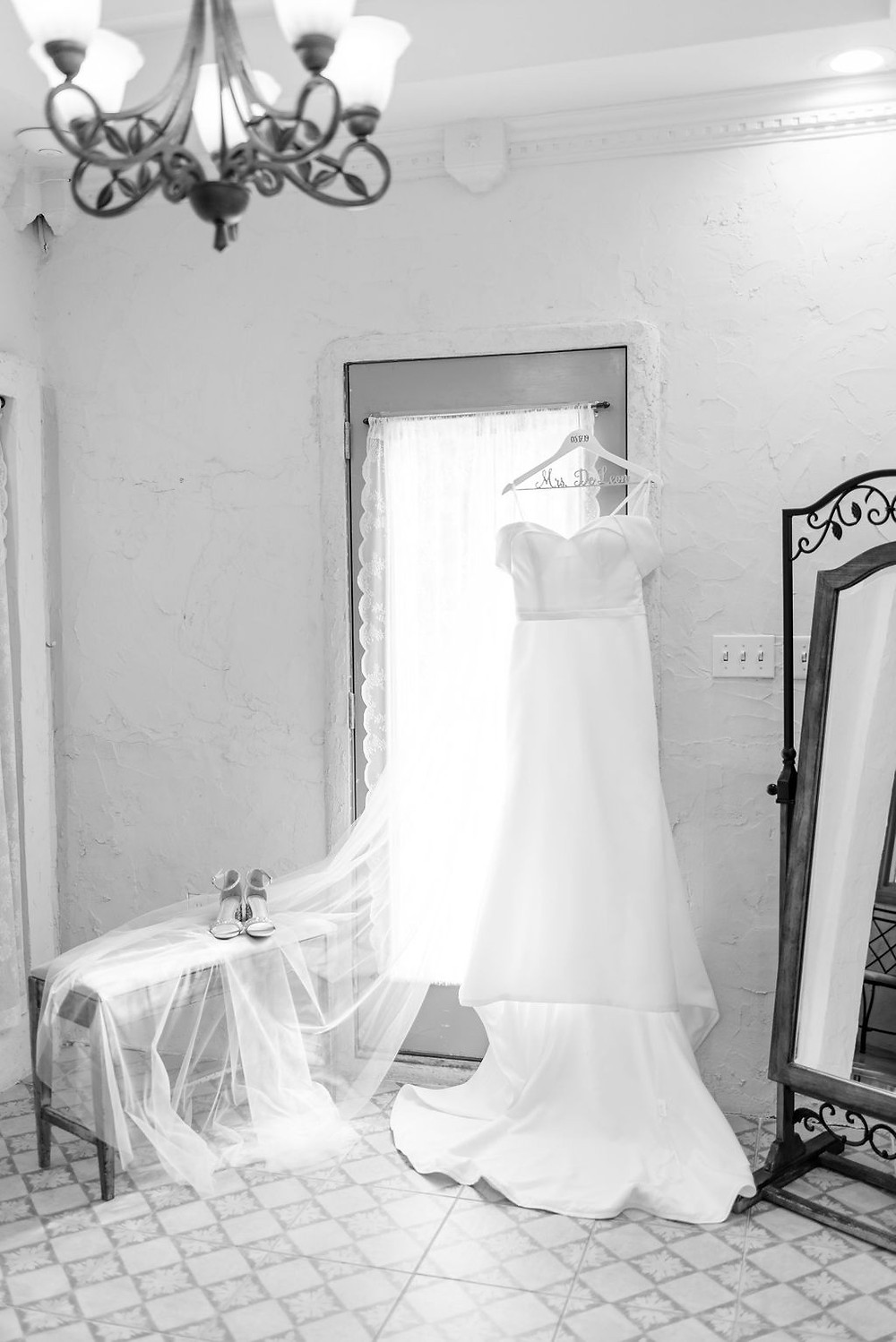 wedding dress hung up in bridal suite of villa antonia