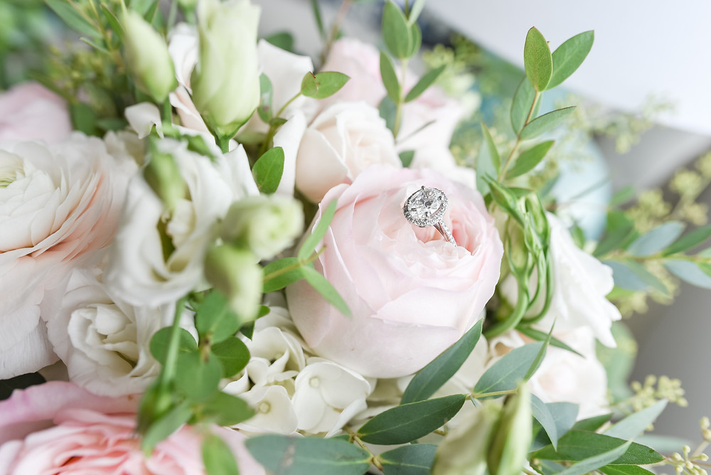 engagement ring in pink rose of bridal bouquet