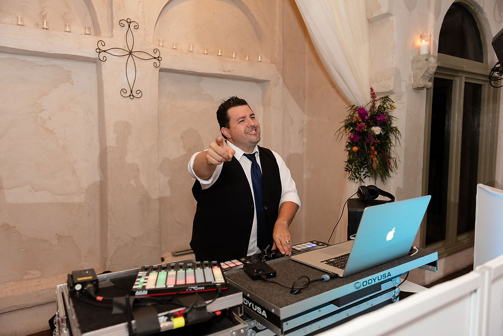 DJ on dance floor in chapel at villa antonia