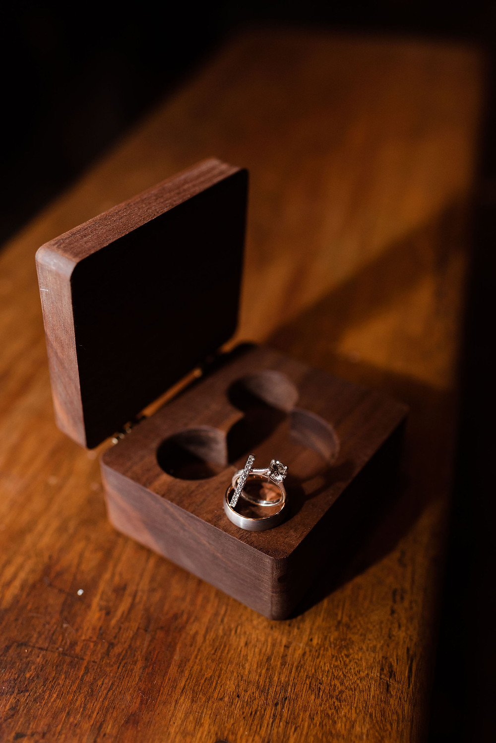 wedding rings on a ring box with mickey mouse cut out