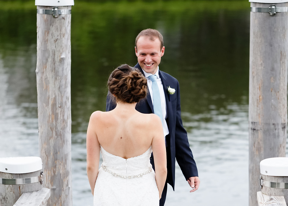 bride and groom first look on dock in cape cod