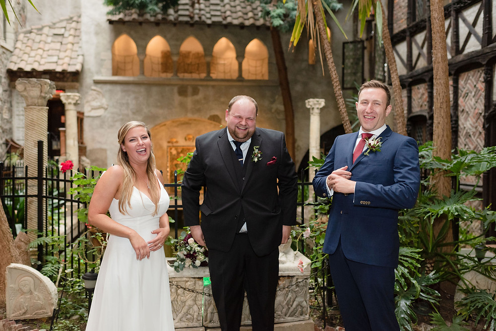 during elopement ceremony everyone looks at the camera and laughs